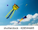 Huge Kites Hovering In The Blu...
