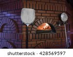 pizza oven baking | Shutterstock . vector #428569597