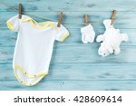 white baby clothes and white... | Shutterstock . vector #428609614