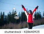 Happy Female Skier Wearing...