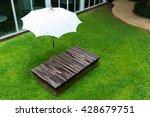 umbrella and wooden bed in... | Shutterstock . vector #428679751
