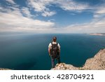 A Young Man Stands On A Cliff...