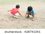 Little Boy Playing With Sand I...
