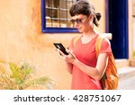girl walking and texting on the ...   Shutterstock . vector #428751067