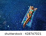woman in a swimming pool | Shutterstock . vector #428767021
