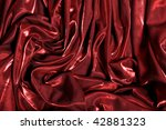 Drapery from a red shock fabric - stock photo