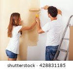 young couple decorate their new ... | Shutterstock . vector #428831185