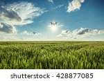 flying drone and green wheat... | Shutterstock . vector #428877085