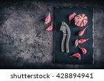fresh garlic bulbs on concrede... | Shutterstock . vector #428894941