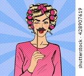 woman winks. attractive girl...   Shutterstock .eps vector #428907619