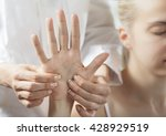 Woman Receiving A Hand Massage...