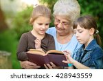 grandmother reading a book for... | Shutterstock . vector #428943559