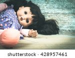 Small photo of Concept Abandoned Person,Abandoned doll laying on old wooden ,vintage tone
