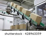 cardboard boxes on conveyor... | Shutterstock . vector #428963359