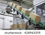 Cardboard Boxes On Conveyor...