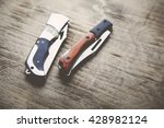 Two Pocket Knife On Wooden ...