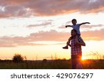 father and son playing at the... | Shutterstock . vector #429076297