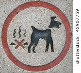 No dog fouling sign, set in a stone paving slab.