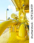Small photo of Pipeline production and control valve for oil and gas process, Petroleum construction on offshore wellhead remote platform, Energy and petroleum industry,Oil and gas or Petroleum is major of the world