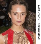 Small photo of New York City, USA - May 2, 2016: Alicia Vikander attends the Manus x Machina Fashion in an Age of Technology Costume Institute Gala at the Metropolitan Museum of Art