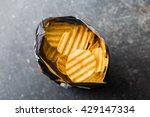crinkle cut potato chips on... | Shutterstock . vector #429147334