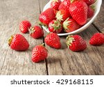Ripe Red Strawberries On Woode...