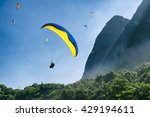 Paraglider Passes Along The...