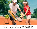 Tennis Lesson   Instructor...