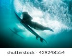 the girl dives under a wave.... | Shutterstock . vector #429248554