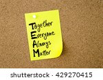 Small photo of Business Acronym TEAM as Together Everyone Always Matter written on yellow paper note pinned on cork board with white thumbtack, copy space available