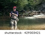 fisherman catches a fish in the ... | Shutterstock . vector #429303421