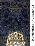 Small photo of SAMARKAND, UZBEKISTAN - 12 OCTOBER 2014: Detail of one window and stalactite decoration in the Timur Amir (Tamerlane) mausoleum, known as Gur E Amir.