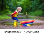 little boy playing in rainy... | Shutterstock . vector #429340855
