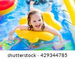 Children Playing In Inflatable...