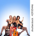 sexy female music band over blue | Shutterstock . vector #42935446