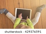 top view of a toddler in green... | Shutterstock . vector #429376591