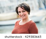 happy mature woman outdoors at... | Shutterstock . vector #429383665