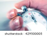 Man Stopping A Stopwatch With...