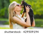 Stock photo dog and his owner cool puppy and young woman having fun in a park concepts of friendship pets 429509194