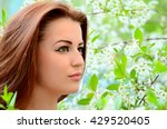 the beautiful woman in flowers... | Shutterstock . vector #429520405