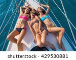 smiling girls lying on yacht....   Shutterstock . vector #429530881