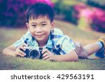 Asian Boy Taking Photo By...