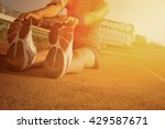 young woman stretching on a... | Shutterstock . vector #429587671
