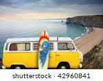 A Yellow Van With A Surf Board...
