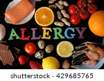 Small photo of Set of allergic food on black wooden background