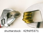wrenches and coins . the... | Shutterstock . vector #429695371