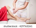 Beautician Waxing Woman A Leg...