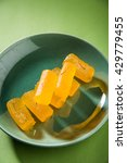 Small photo of Delicious Sweet Pumpkin Pieces or Dry kesar Petha sweet, selective focus