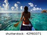 woman paddling canoe in tahiti   Shutterstock . vector #42983371