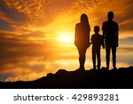 Family Silhouette In Sunset ...